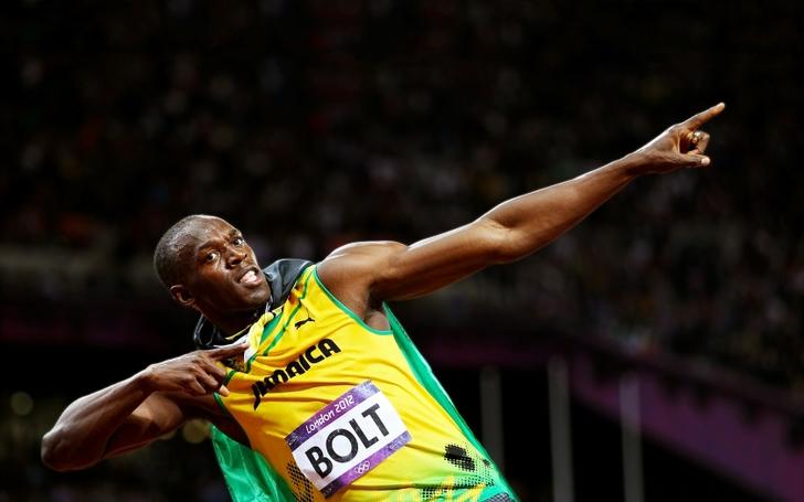 athletes celebration usain bolt posed arms raised winning olympics ...