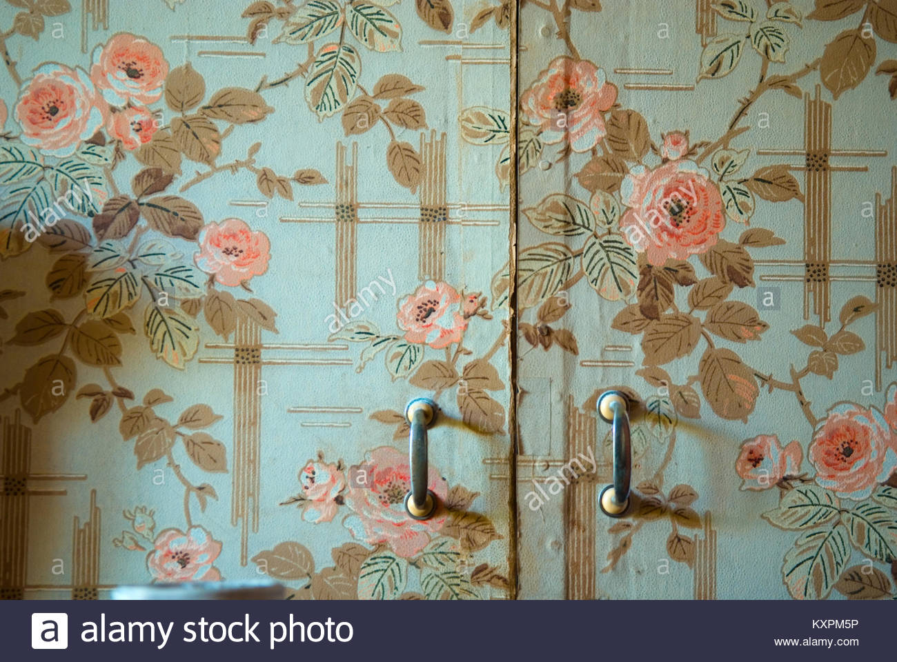 close up of wardrobe doorl with old wallpaper from 1920s in a 1300x960
