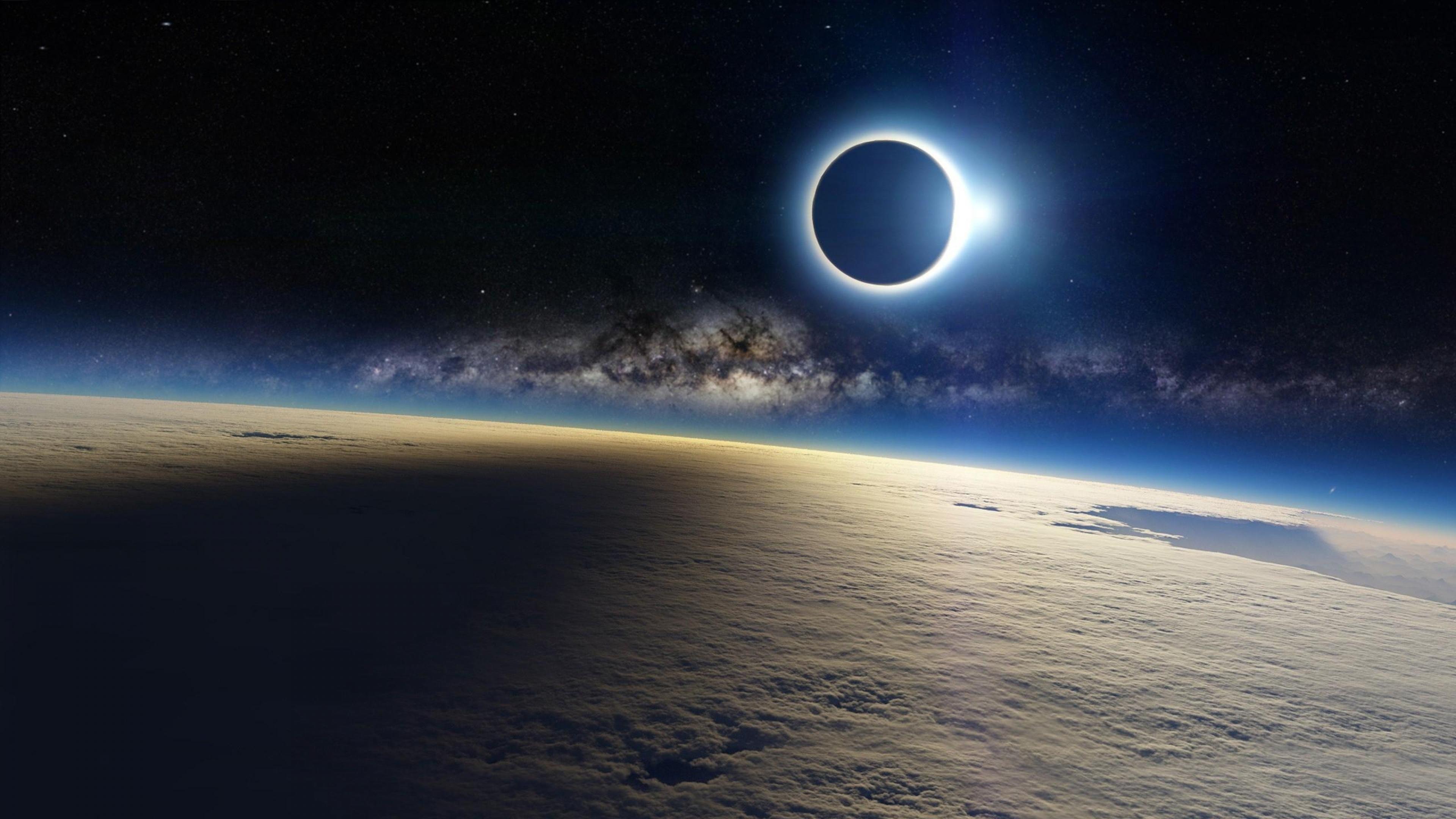 Download Wallpaper 3840x2160 clouds milky way eclipse light 4K 3840x2160