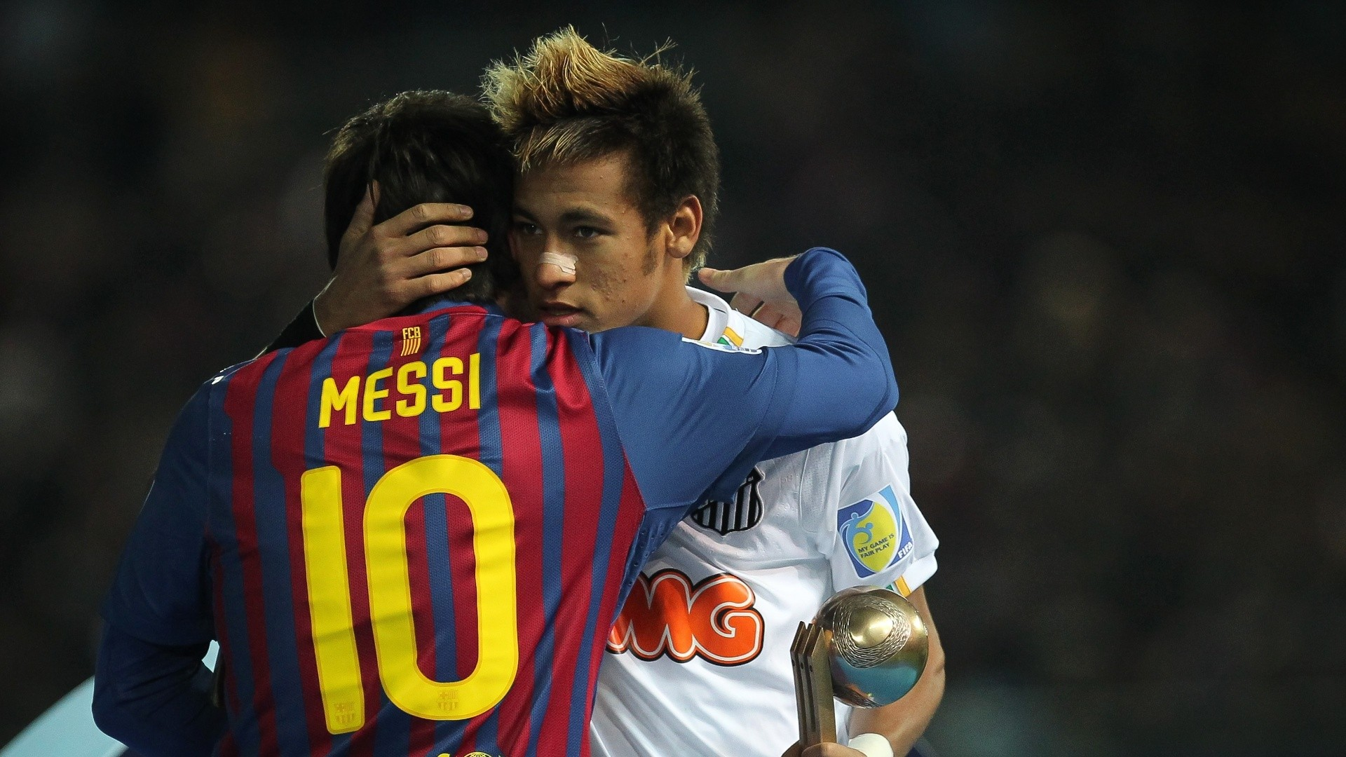 Neymar and Lionel Messi hugging each other 1920x1080