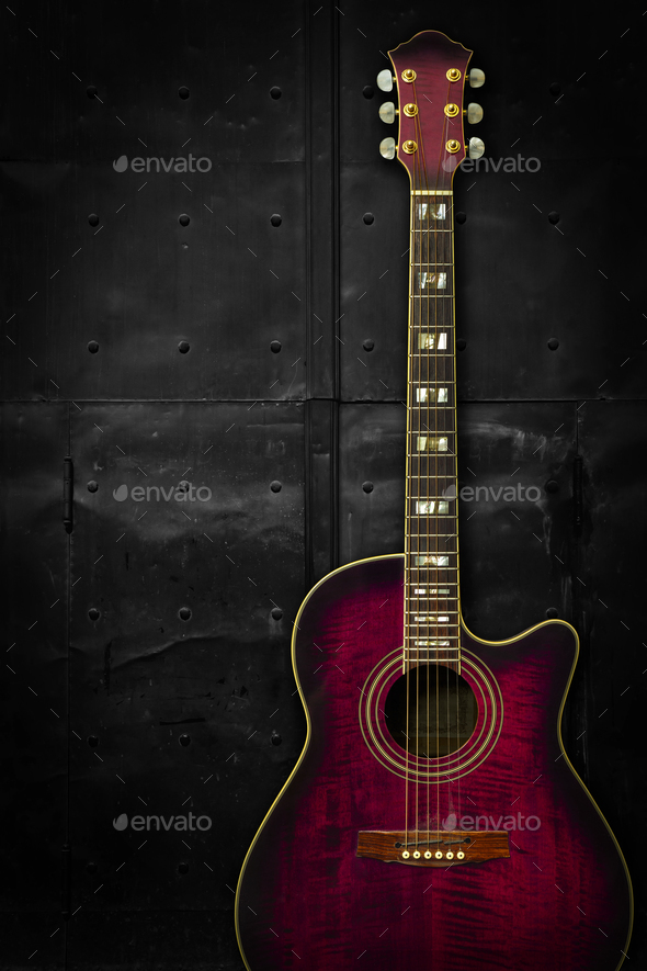 Purple acoustic guitar over dark background Stock Photo by sumners 590x885