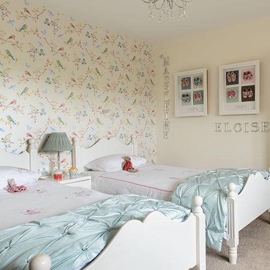 Girls twin bedroom with bird wallpaper Childrens room decorating 550x550