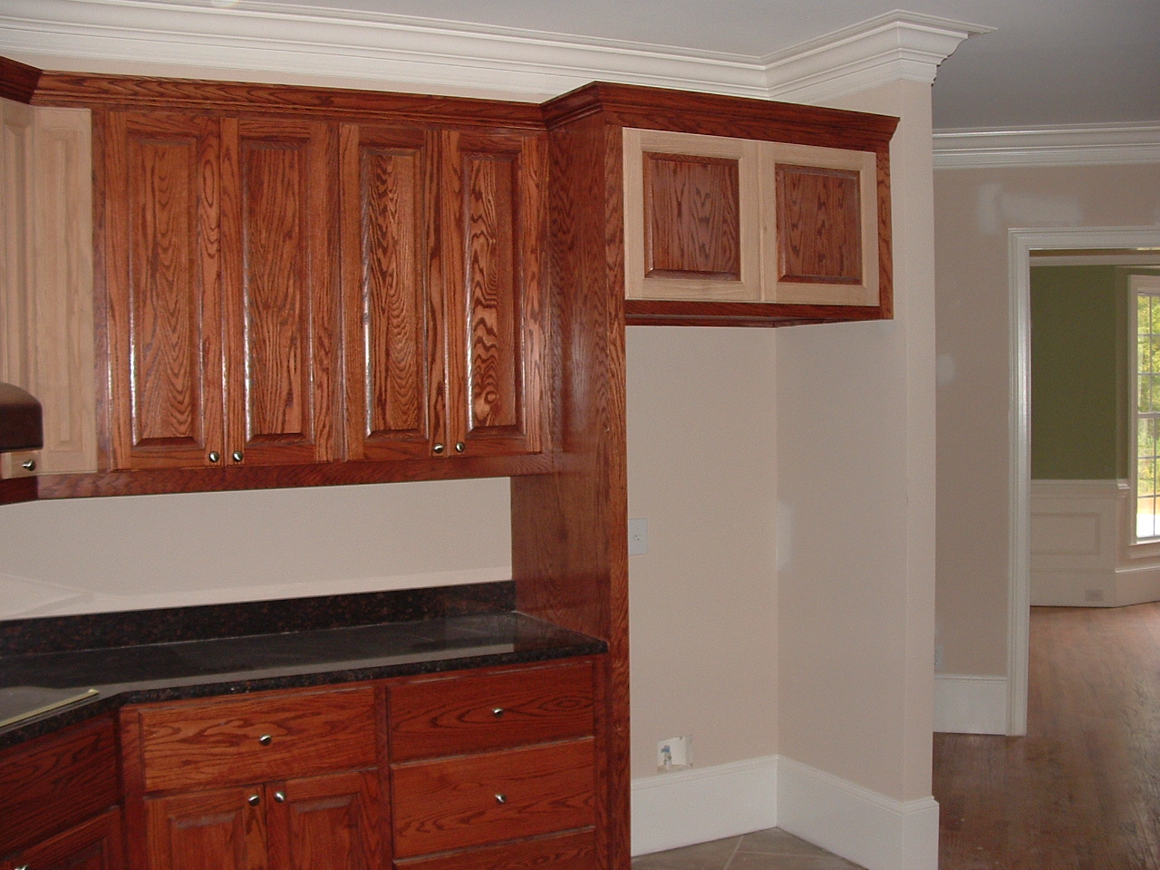 Stained Kitchen Cabinets With Pocket Doors Over Fridge Closed 1280x960