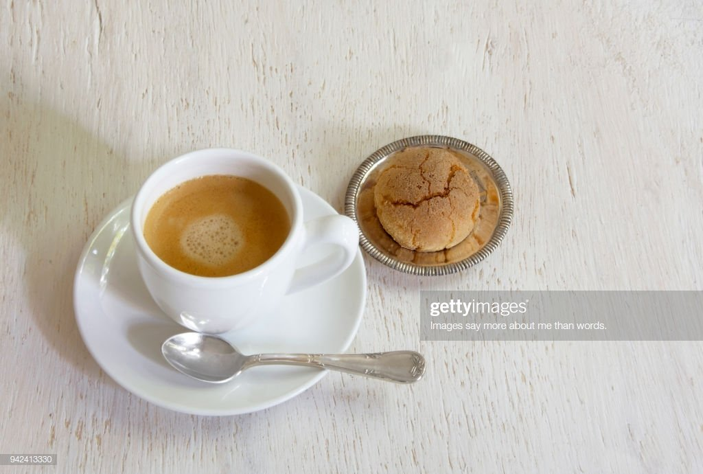 A Cup Of Expresso With A Cookie Aside Over A White Background 1024x690