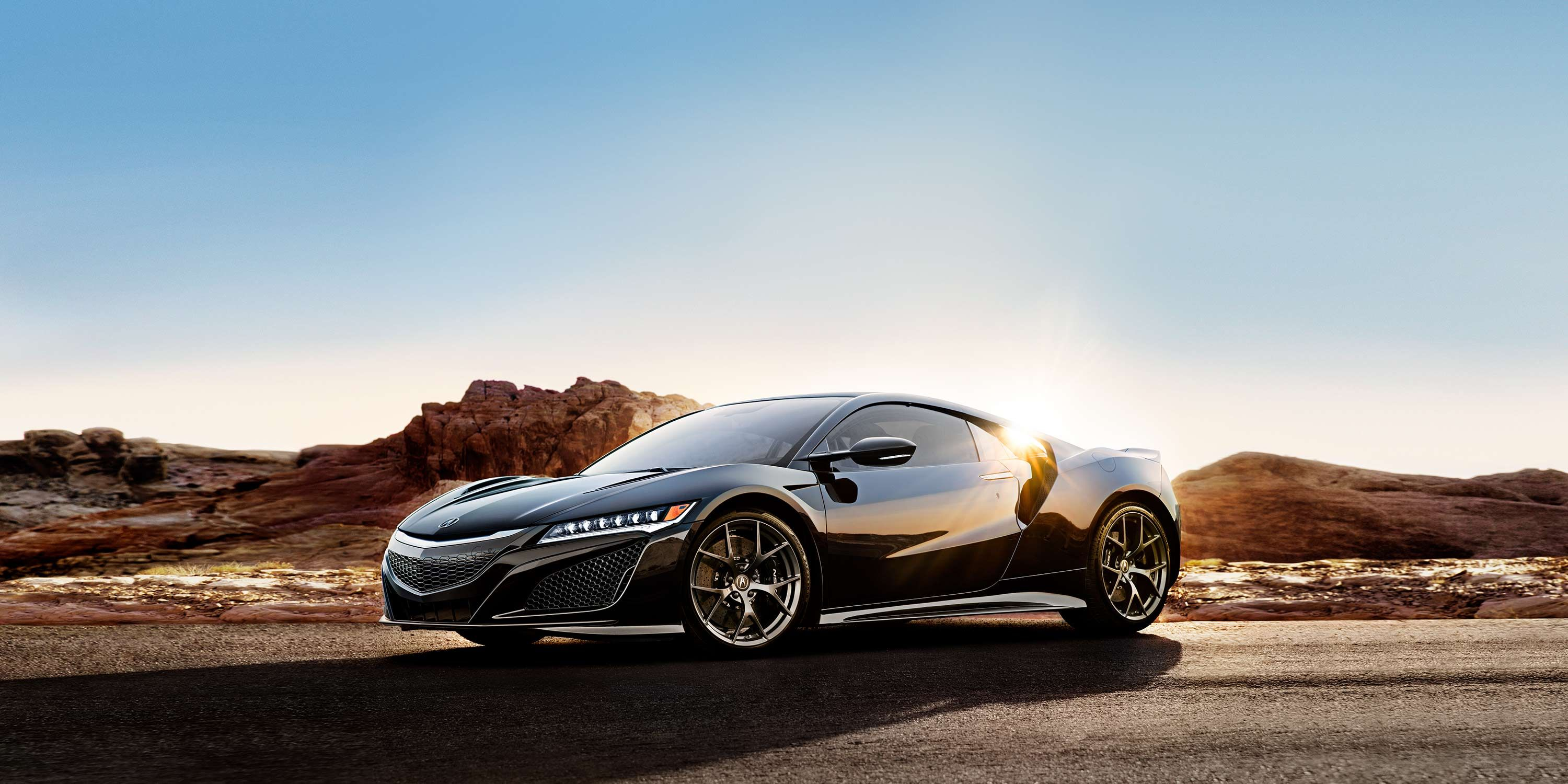 Drivers side front 34 of black NSX with desert background 3000x1500