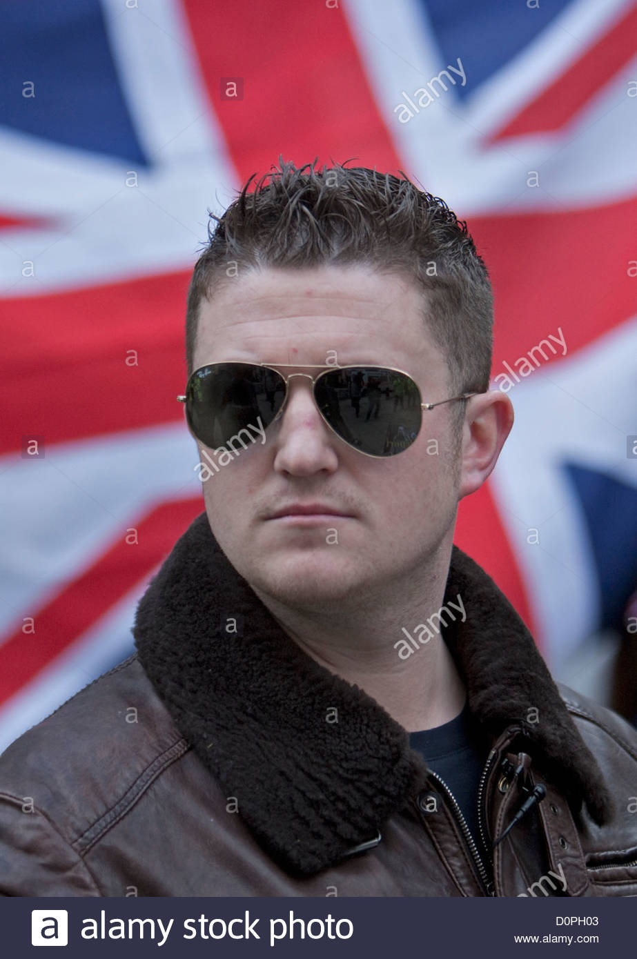 Tommy Robinson of EDL english defense league with a union flag 923x1390