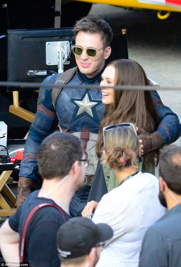 Elizabeth Olsen and Chris Evans on the set of Captain America 634x932