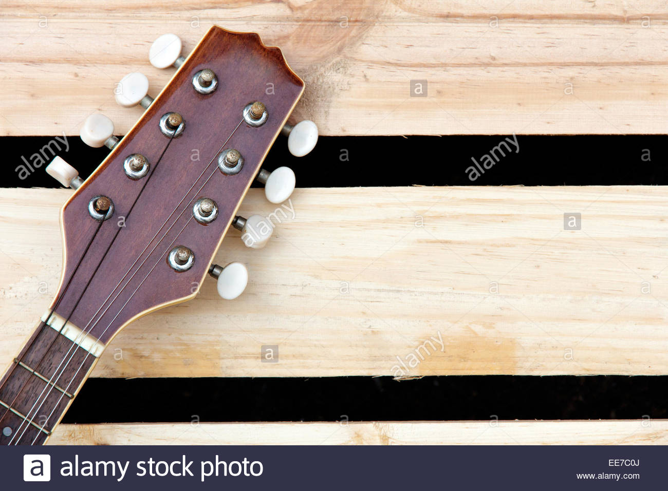 mandolin headstock background Stock Photo 77609746   Alamy 1300x956