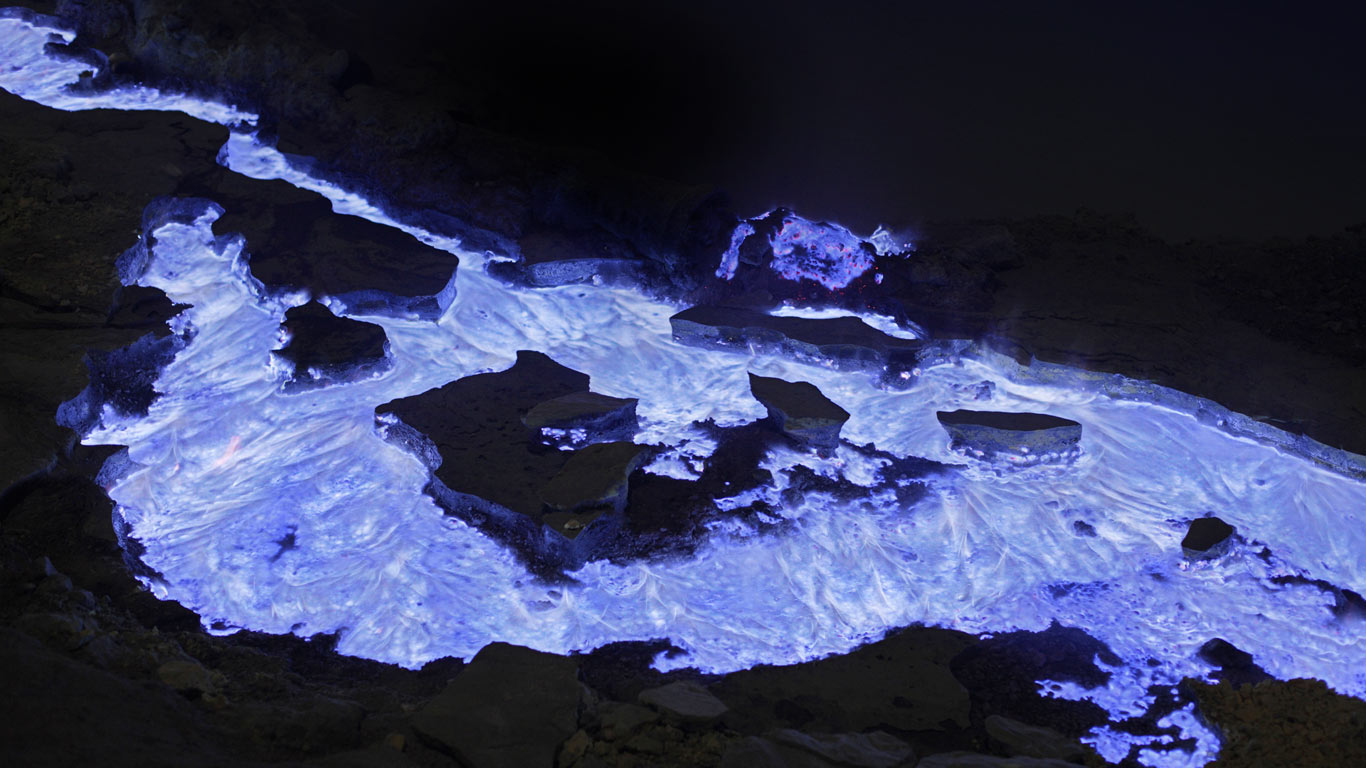 Flaming sulfur from Kawah Ijen volcano Indonesia wallpaper by 1366x768