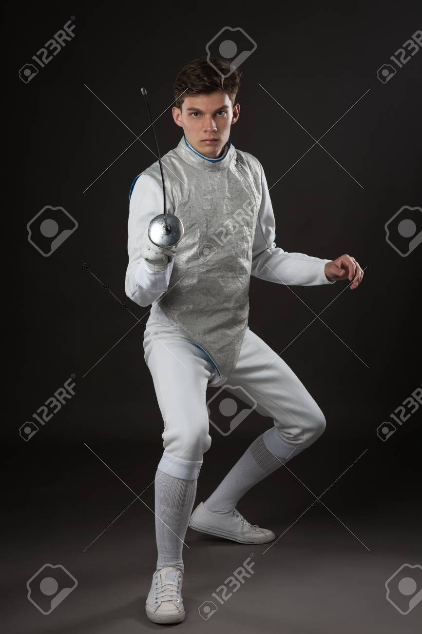 Portrait Of Young Male Fencer In White Fencing Costume Attacking 866x1300