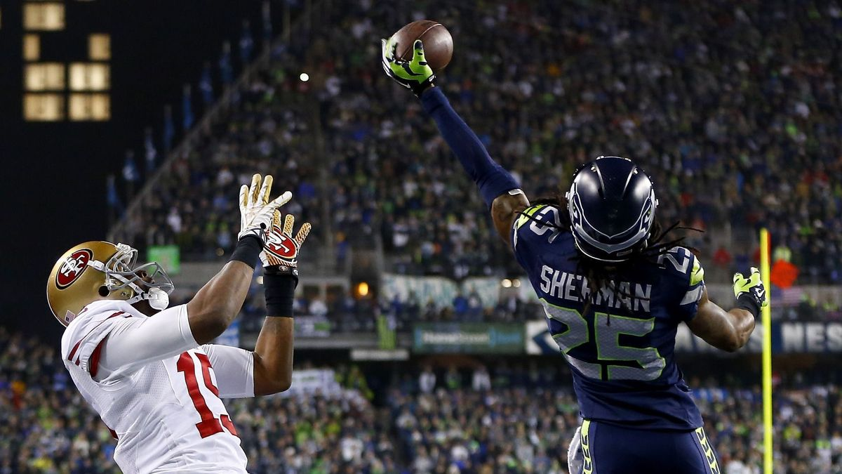 Cornerback Richard Sherman 25 of the Seattle Seahawks tips the ball 1200x675