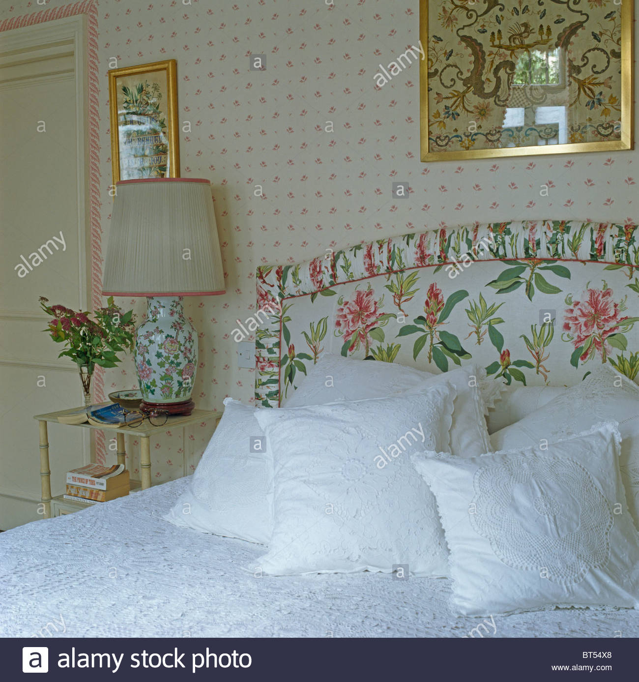 White lace edged cushions on bed with upholstered floral headboard 1300x1387
