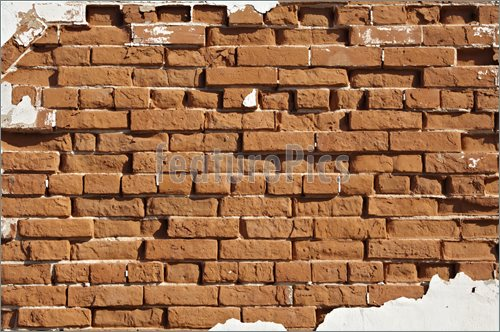 Abandoned brick wall suitable for background with plenty of copyspace 500x332