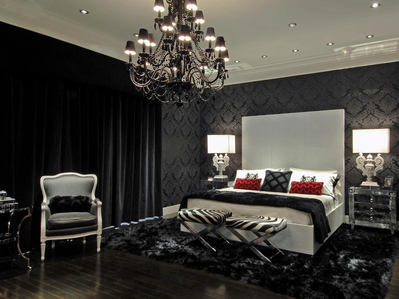 black bedroom with damask wallpaper and black chandelier layers and 1280x960