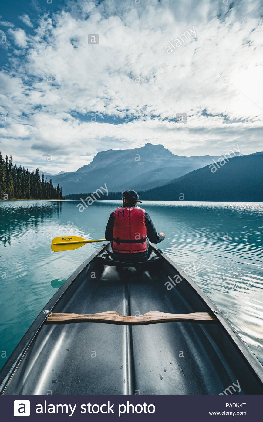 Young Man Canoeing on Emerald Lake in the rocky mountains canada 867x1390