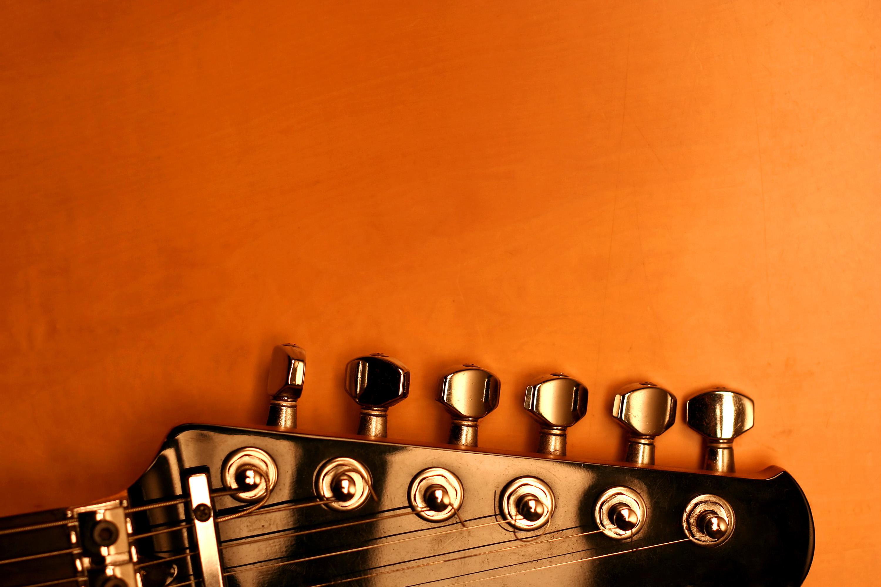 guitar head pic with orange background hd wallpapers 3000 x 2000jpg 3000x2000