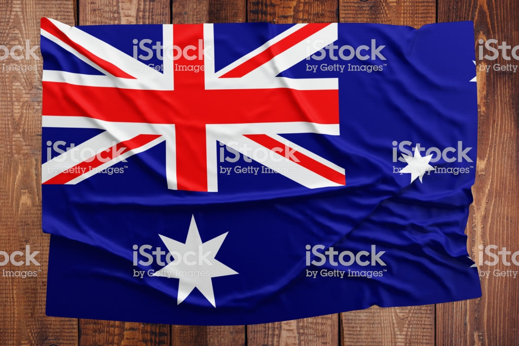 Flag Of Heard Island And Mcdonald Islands On A Wooden Table 1024x683