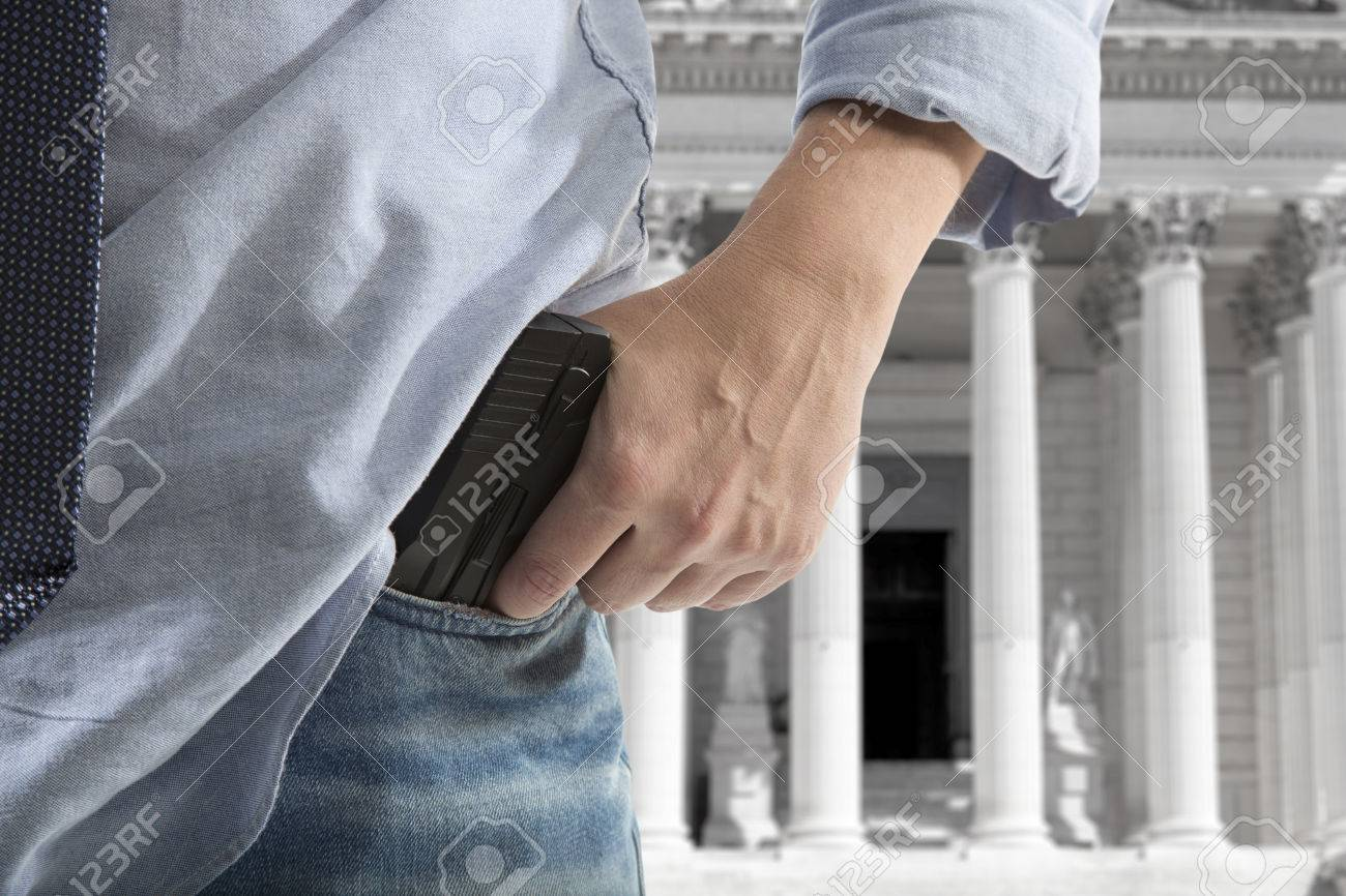 Security Man Holding Gun Against An Courthouse Background Stock 1300x866