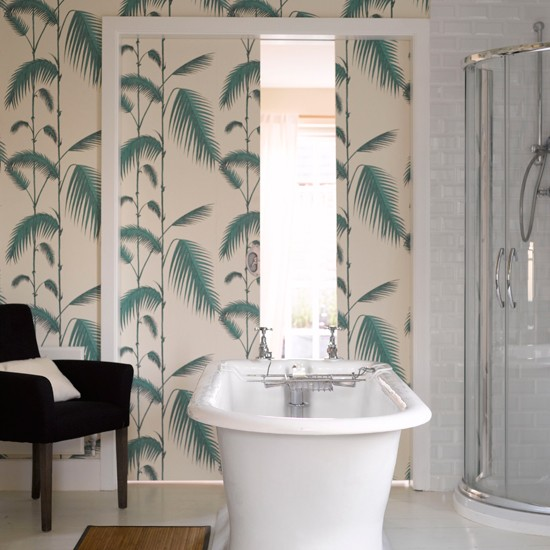 Bathroom with green fern print wallpaper freestanding bath and black 550x550