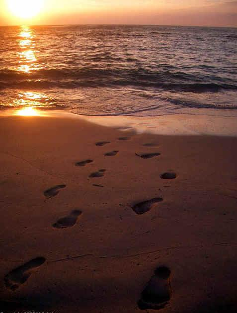 footprints of god in sand 477x630