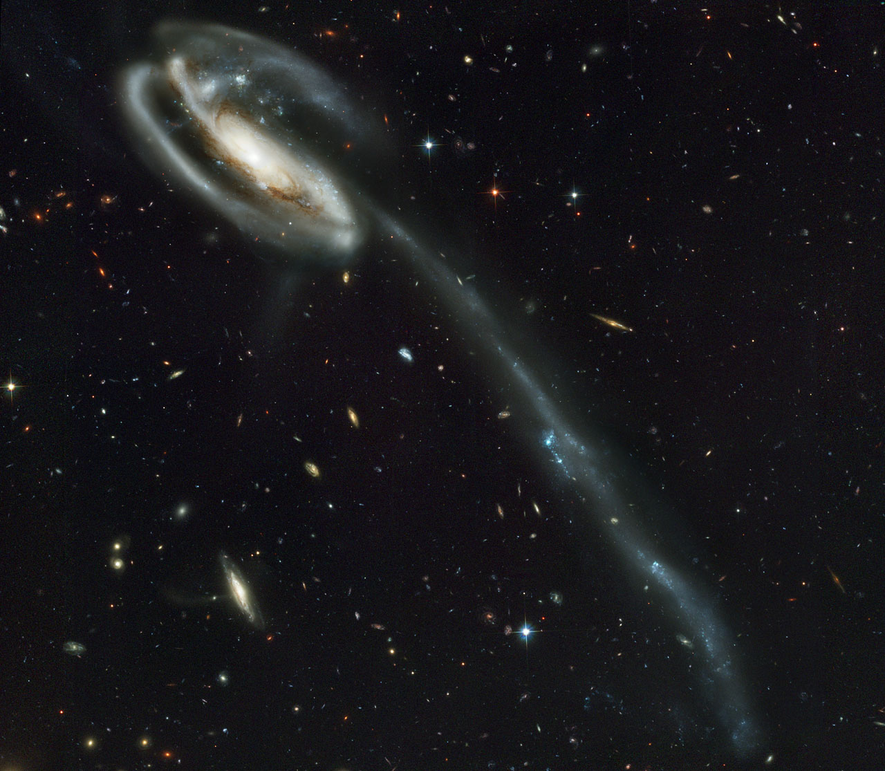A wallpaper of distant galaxies is a stunning backdrop for a 1280x1115
