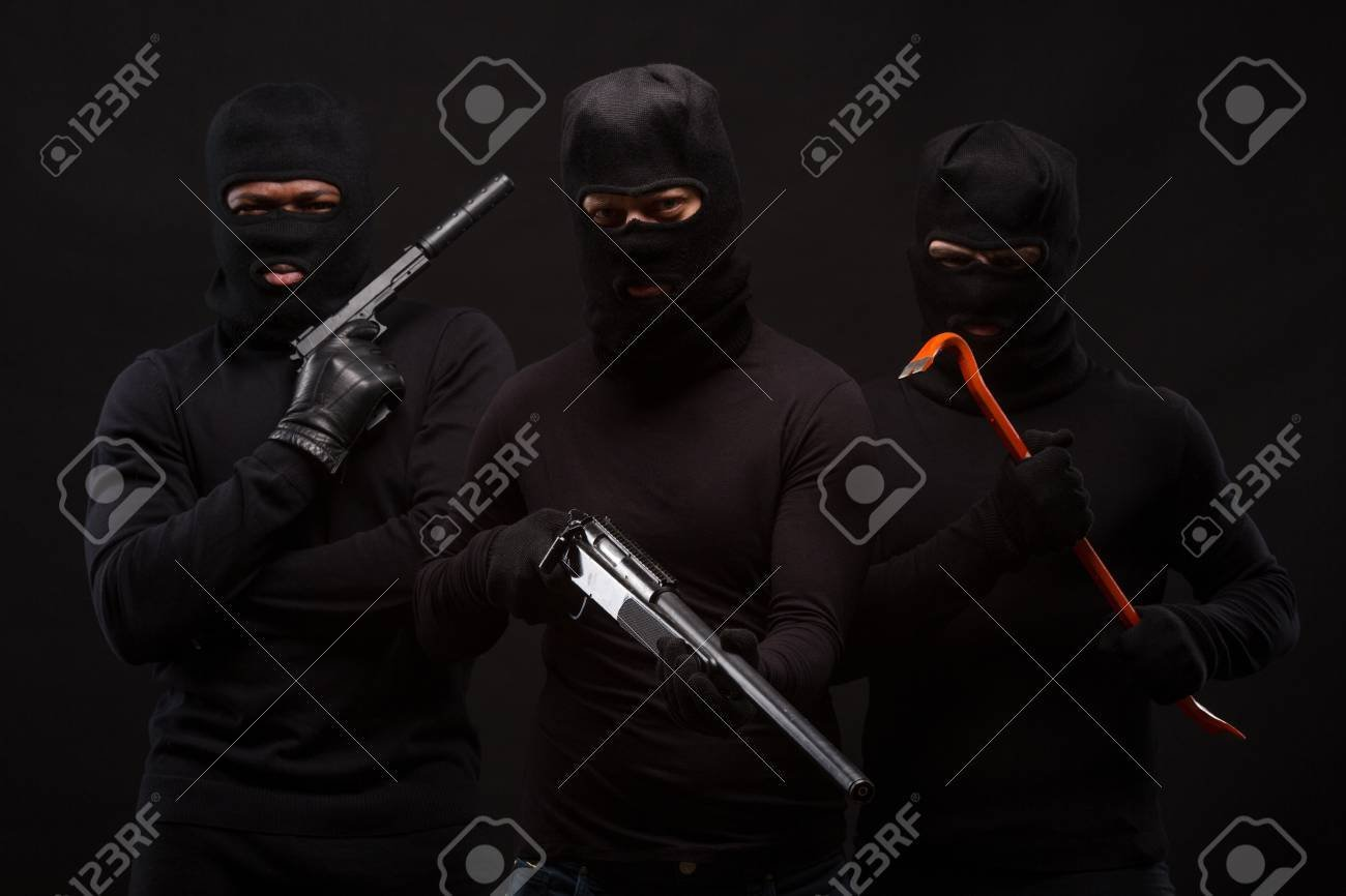 Murders In Masks With Machine guns And Crowbars Over Black 1300x866