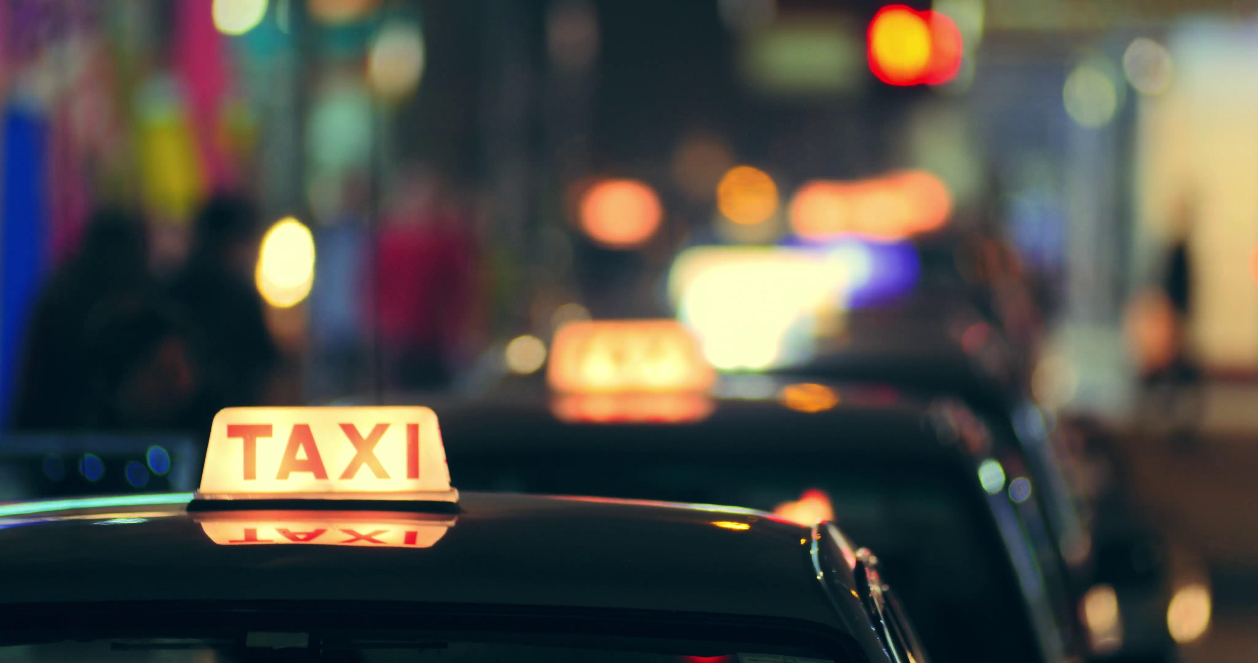 Many taxi cars in Hong Kong downtown at night Abstract city 4096x2160