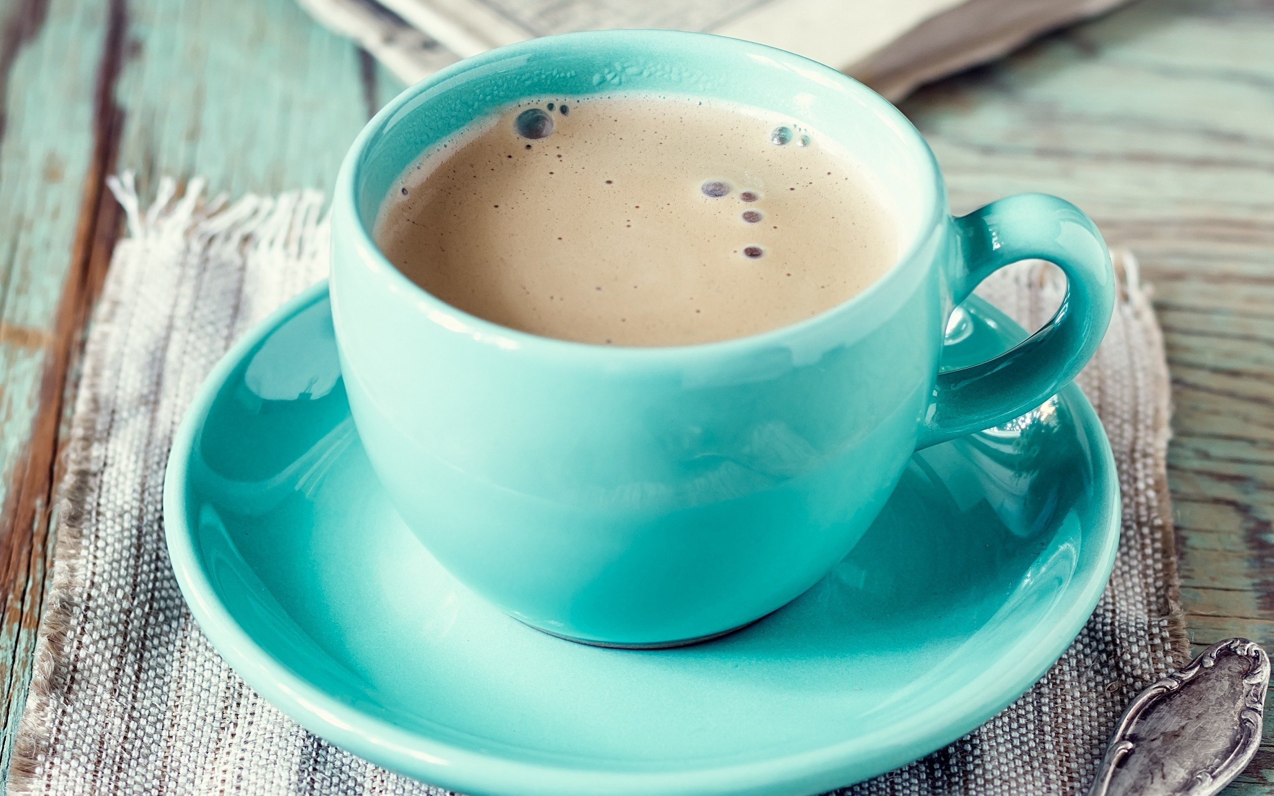 Blue cup with saucer of cappuccino on rustic wooden table hd 2560x1600