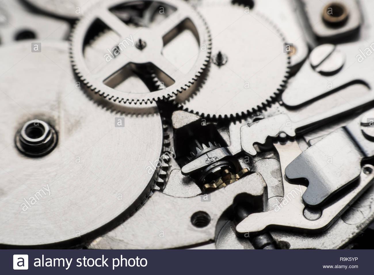 Mechanical watch Gear Clock Close up cogs and gears inside 1300x956