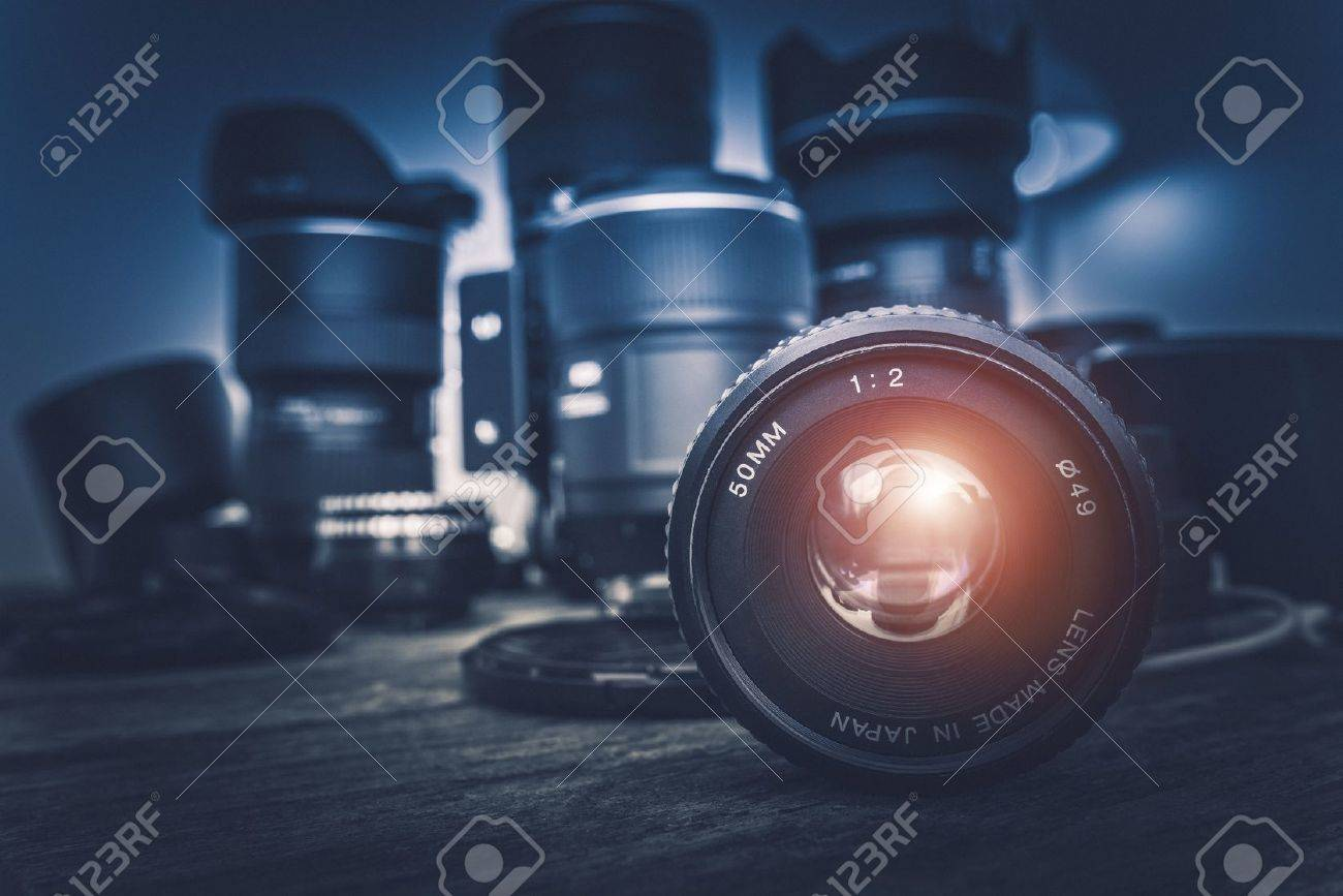 Camera Lens And Photography Equipment In The Background 1300x867