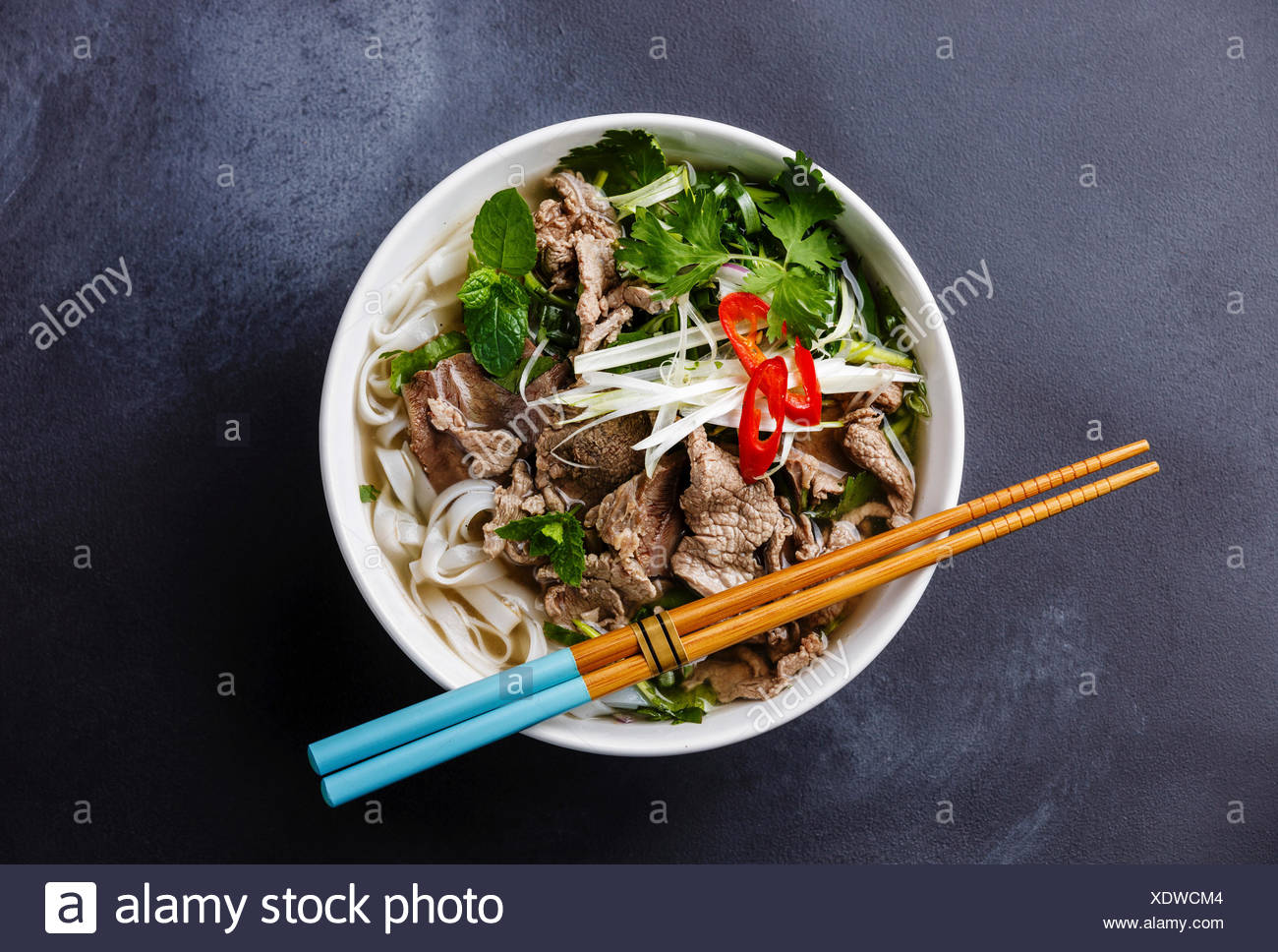 Pho Bo vietnamese Soup with beef on dark background Stock Photo 1300x968
