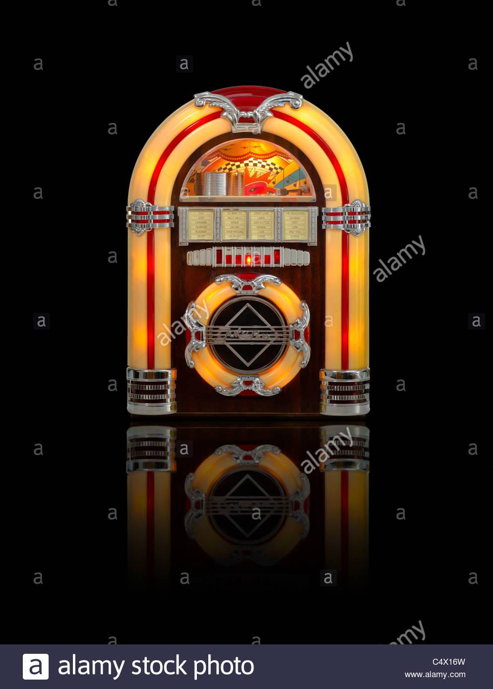 Retro jukebox radio isolated on black background with reflection 994x1390