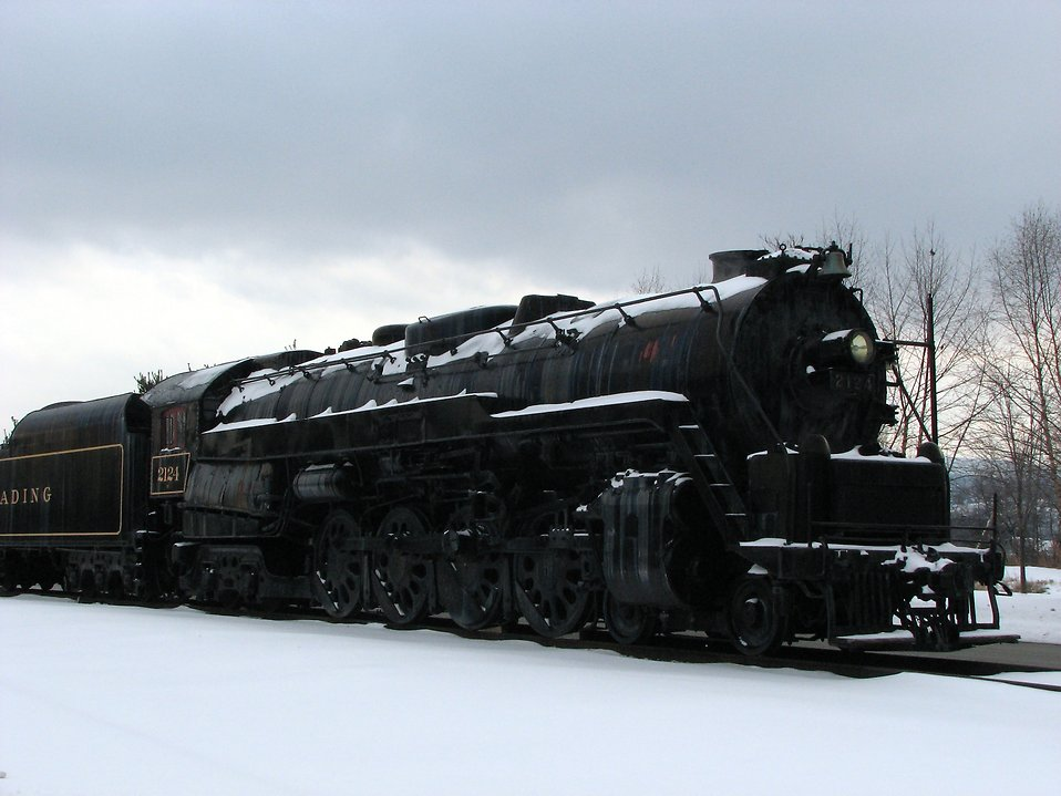 Train Stock Photo A steam locomotive under a stormy winter 958x719