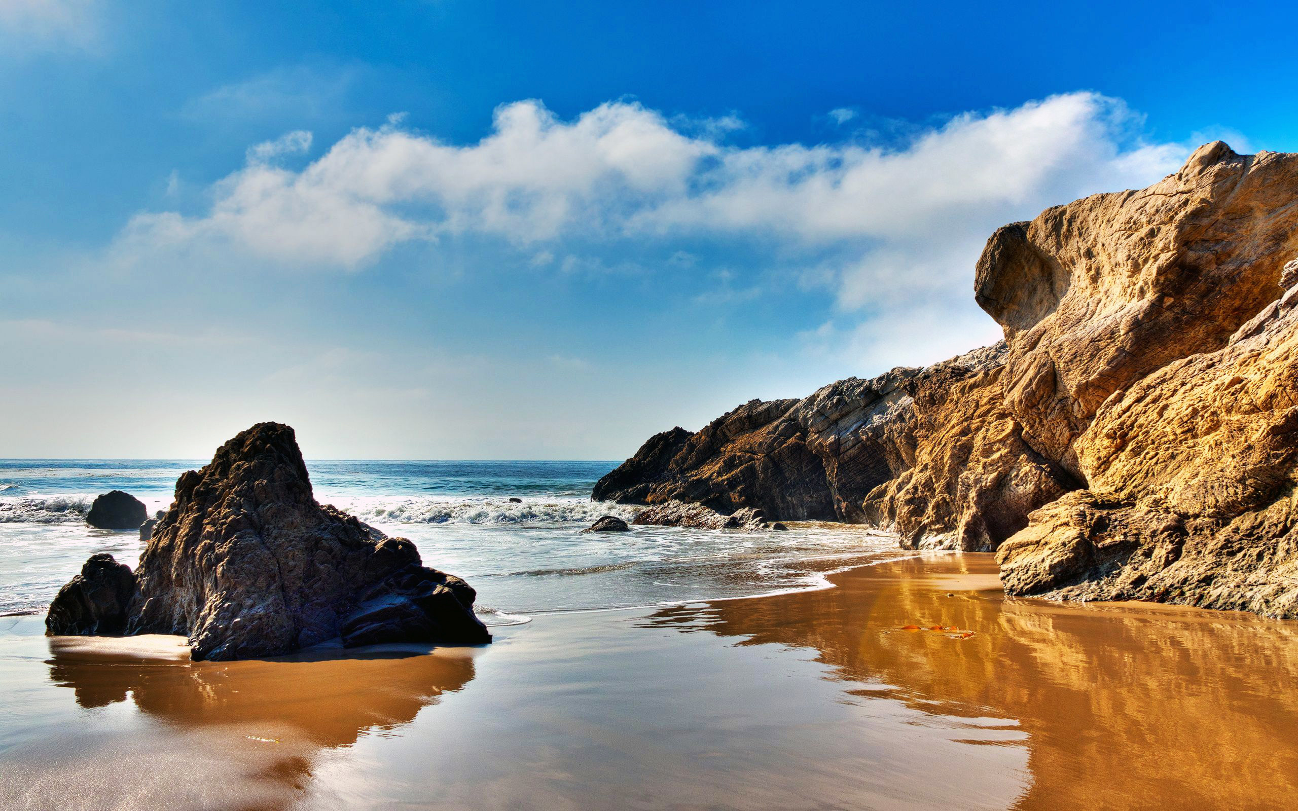 The wallpaper of beach at the Pacific Ocean in Malibu California 2560x1600