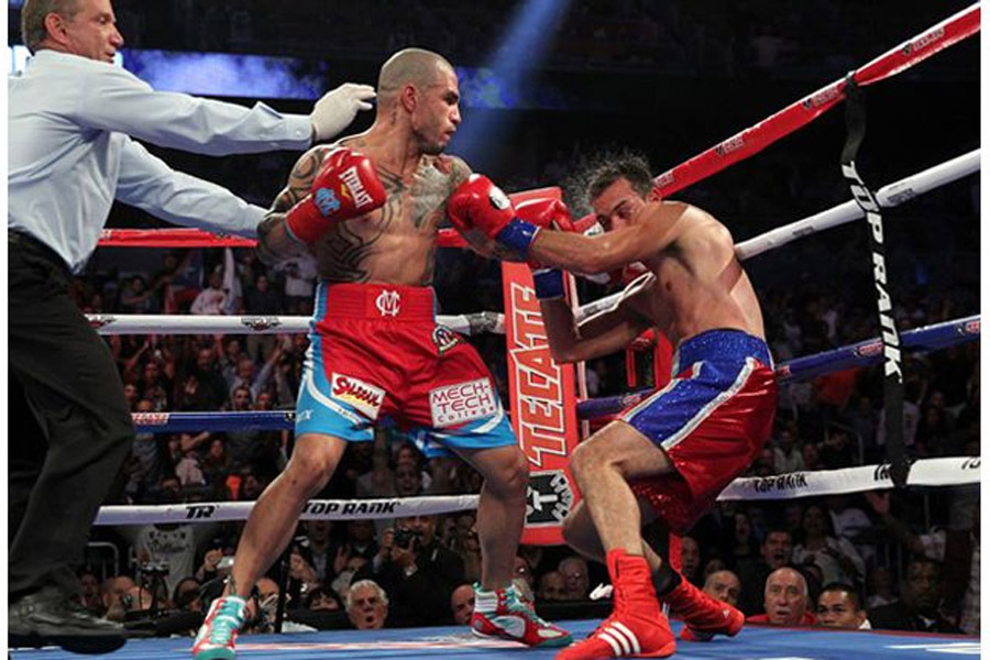 Boxing results Miguel Cotto revives career with a TKO win 900x600