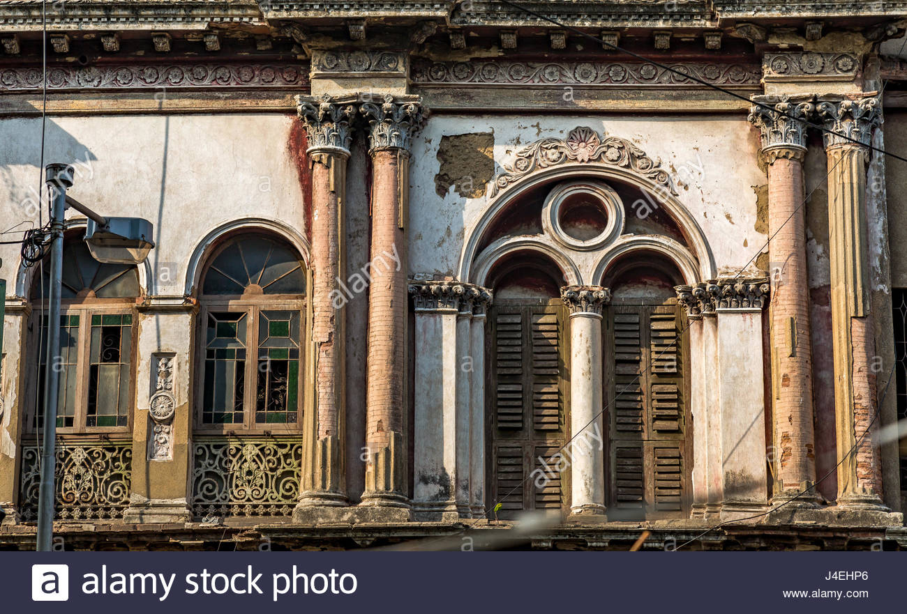 Neoclassical vintage building exterior with brick wall weathered 1300x881