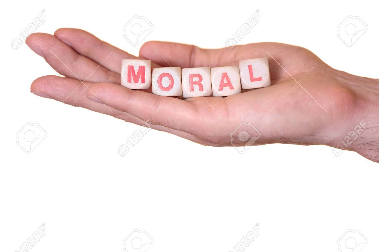 The Word Moral Written With Wooden Dice On The He Palm Of The 1300x866