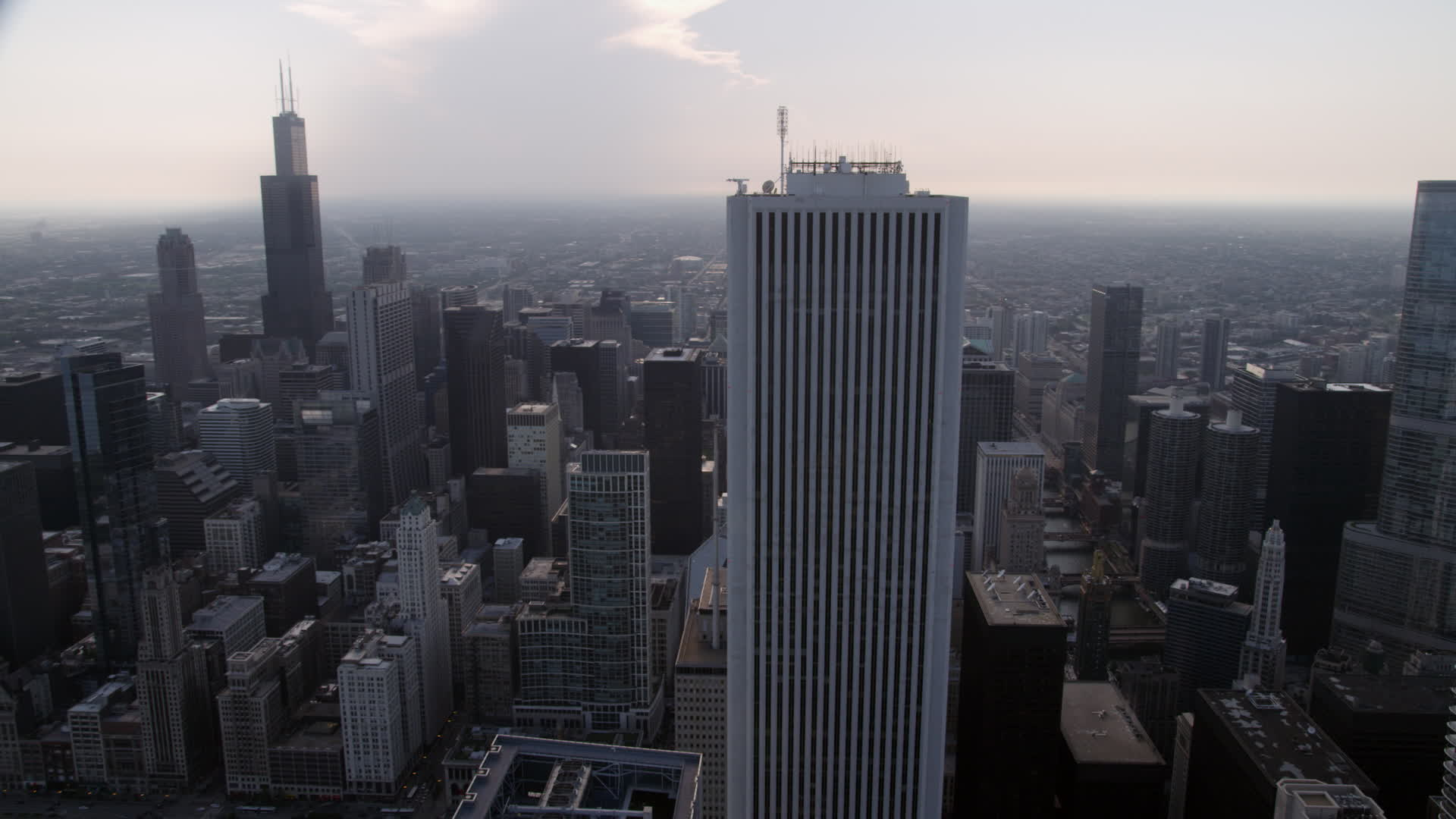 5K stock footage aerial video Orbiting Aon Center with Downtown 1920x1080