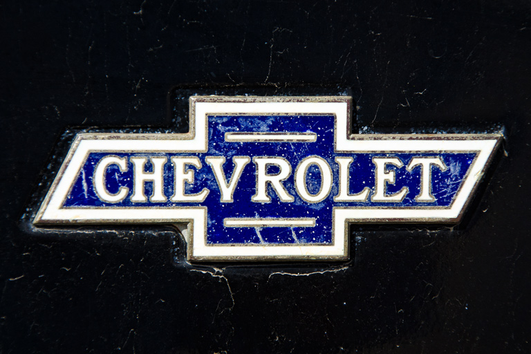Action Photo is a picture of the Chevrolet logo on an old Chevy 768x512