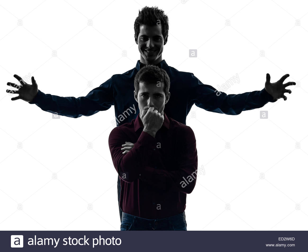 two young men domination concept shadow white background Stock 1300x1063