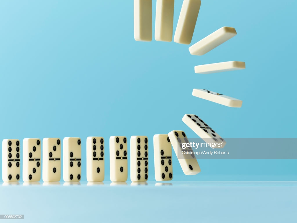 Flipping Dominos On Blue Background Stock Photo   Getty Images 1024x768