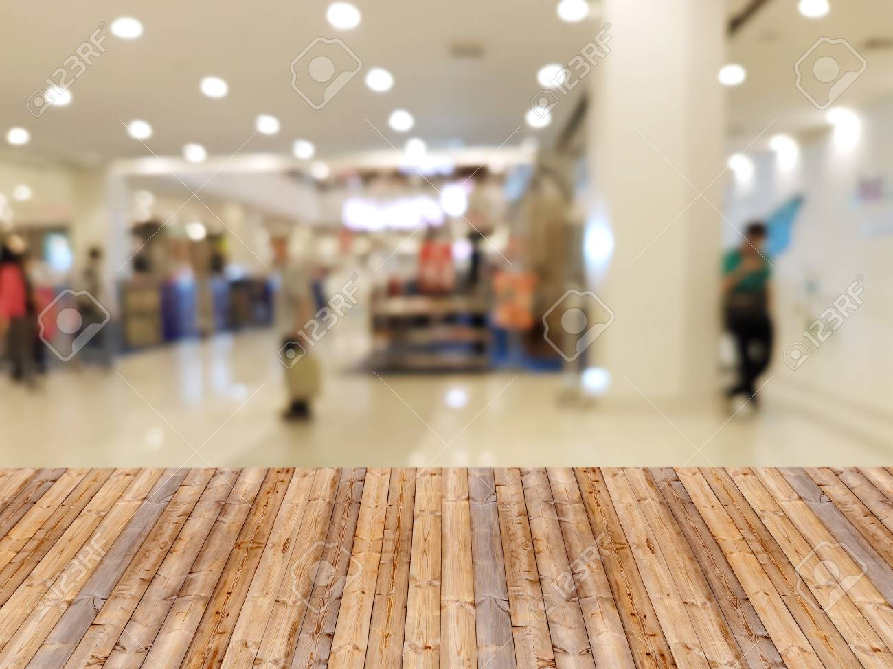 Wooden Table With Shopping Mall Blurred Background Stock Photo 1300x975