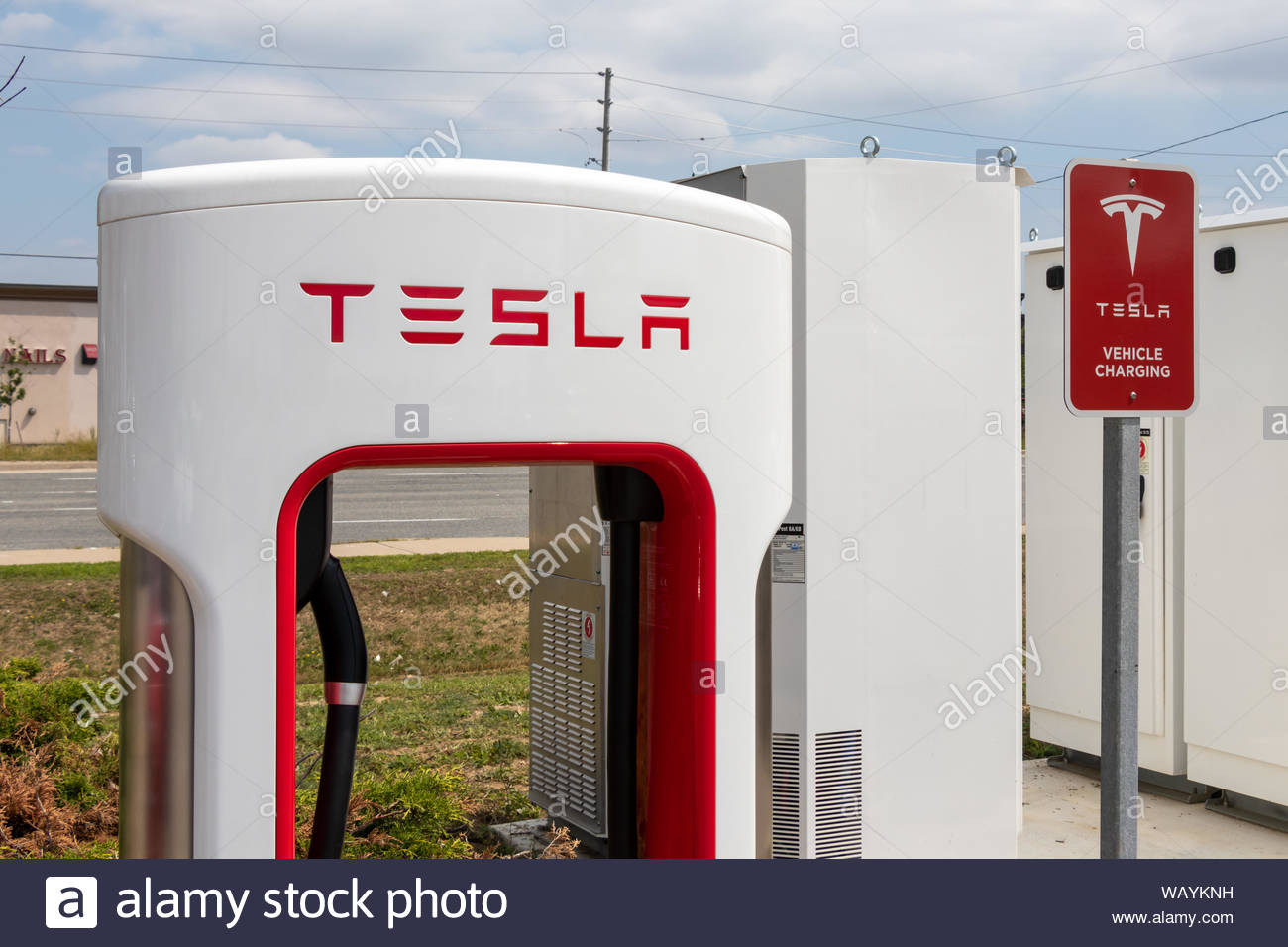 Tesla Supercharger and Tesla Vehicle Charging Sign with power 1300x956