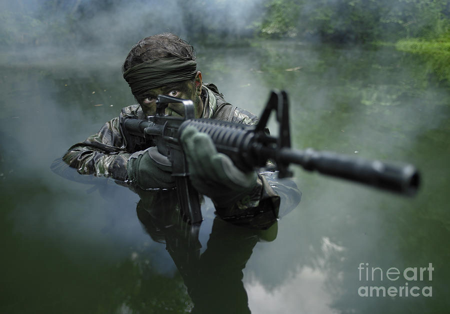 File:US Navy 090718-N-6403R-763 A Navy SEAL sniper waves ...  |Navy Seals Emerging From Water