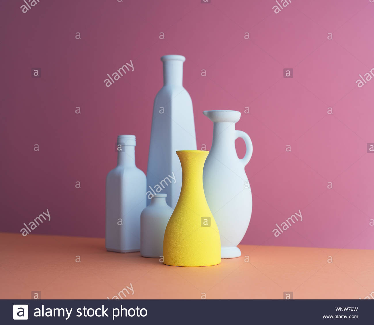Multiple types of colorful bottles organized over pink background 1300x1131