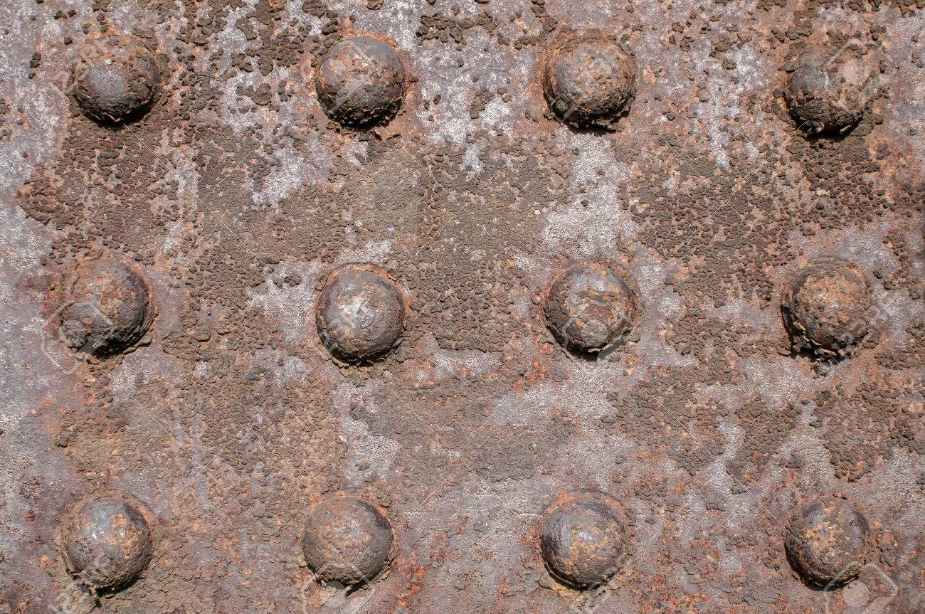 Weathered Rusty Iron Element With Centennial Rivets Link As 1300x863