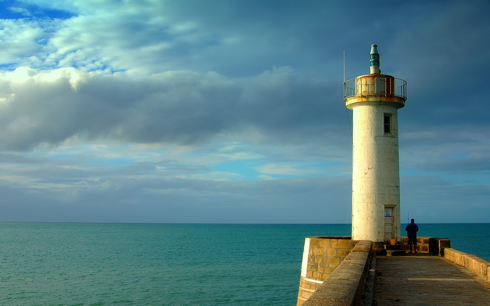 Lighthouse on the coast Wallpaper Wallpaper Collective 1680x1050