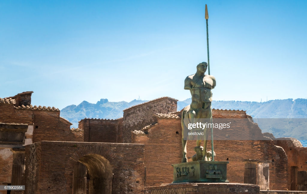 Pompeii Statue And Ruins In Background Stock Photo   Getty Images 1024x648