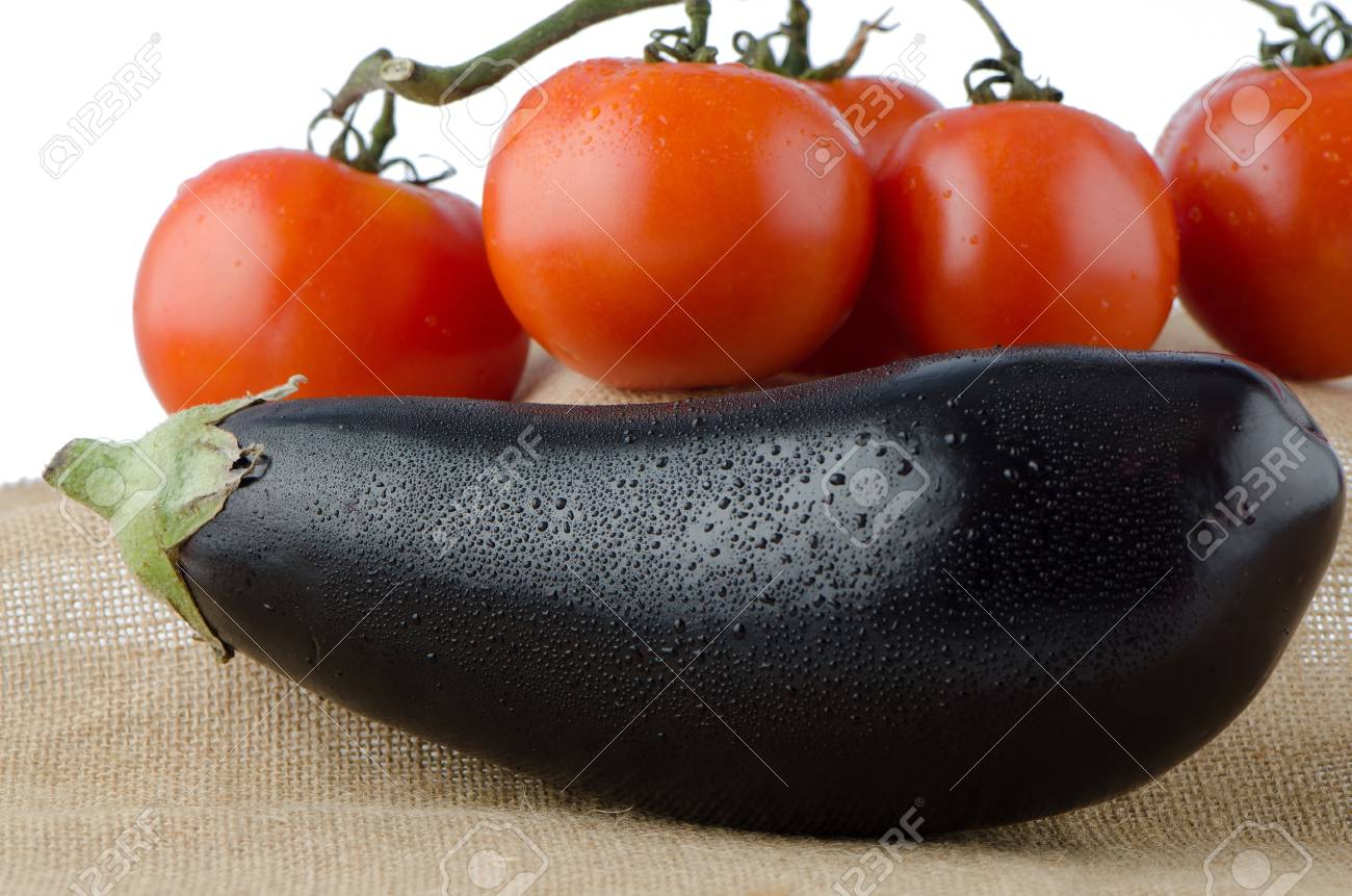 Eggplant And Cherry Tomatoes Vineover Raffia Background Stock 1300x861