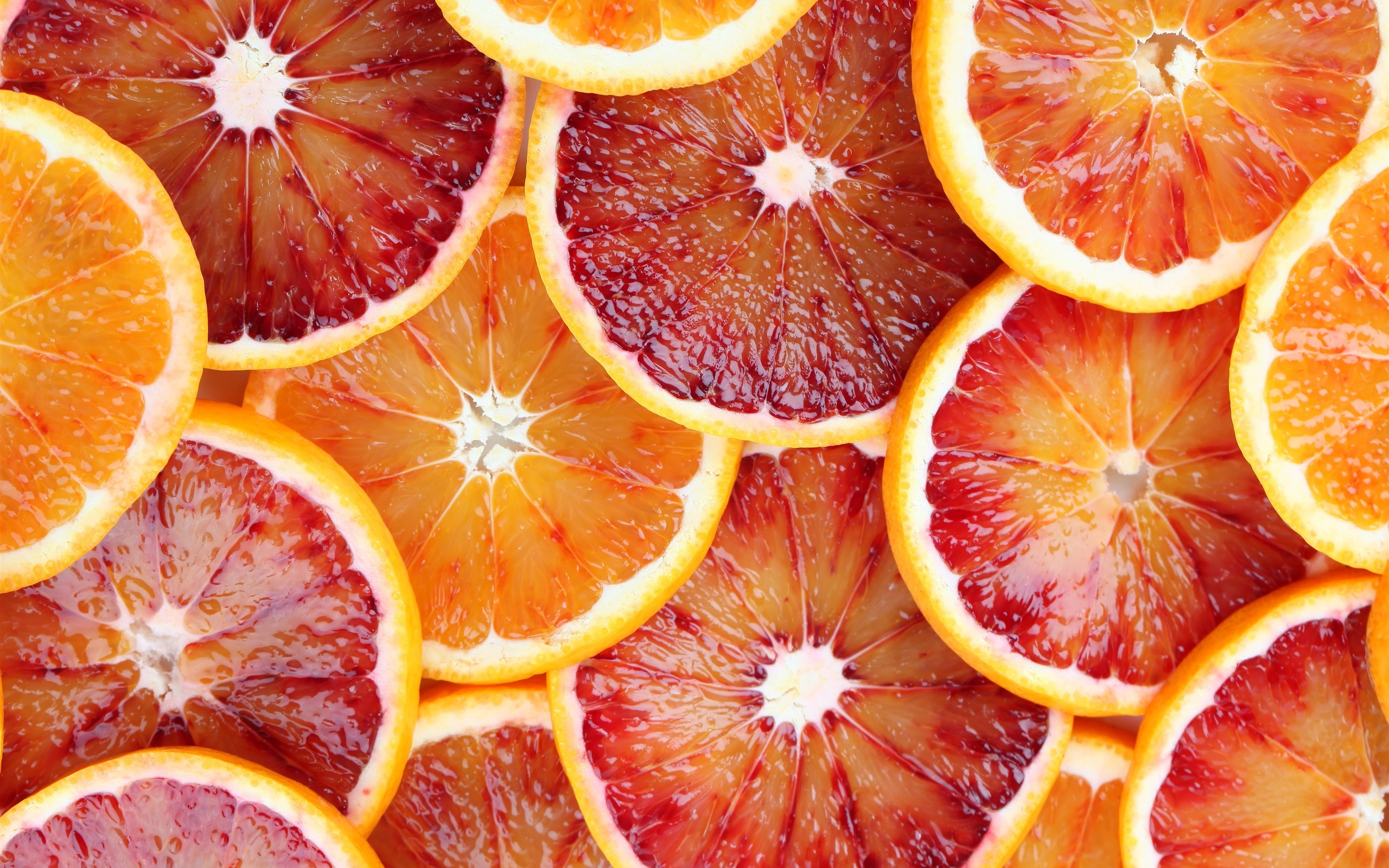 Wallpaper Fruit slices oranges grapefruit juice red and yellow 2560x1600